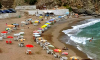 """الحسيمة .. """"أعداء السياحة"""" يحتلون الشواطئ ويَبتزّون المصطافين"""